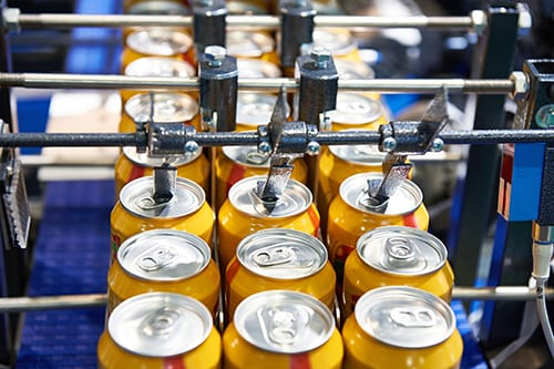 Dry Lubricant Reduces Water Usage and Maintains Clean Conveyors in a Soft Drink Facility